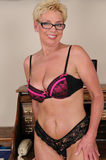 47 Year Old Taylor Lynn Getting Naked Plus Spreading About Her Desk