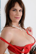 Hot and Busty Kelly Capone Slips out of Her Red Lace to Pose Here