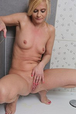 Cute Blond Haired 44 Year Old Starlet Getting Herself Cookie off in the Shower