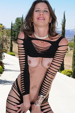 Cute 41 Year Old Jizzabelle from Onlyover30 Stretching on the Patio