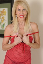 60 Year Old Erica Lauren in Slinky Red Lingeries Lazily Unclothing