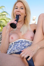 60 Year Old Erica Lauren Plugs Her Older Hairy Pussy in the Backyard