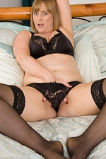 Breasty Older April Looks Passionate in Her Ebony Underware Playing with Herself in Bed