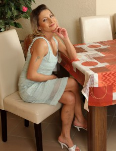 Puny 45 Year Old Syndi Bell from  Onlyover30 Stretching Her Long Gams