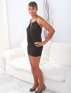 Perverted  Cougar Christing Stips off Her Dress and Widens Her Dark Gams