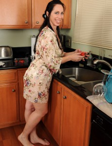Tall Aged Brunette Hair with Large  Boobs  Opens in the Kitchen