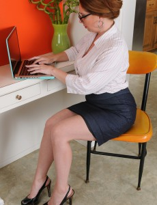 Breasty Secretary Kiki Daire Fingers Her 39 Year Old Pussy at Her Desk
