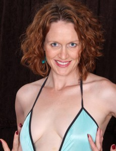 35 Year Old Redheaded Roxanne Clemments Liking Her Purple Toy
