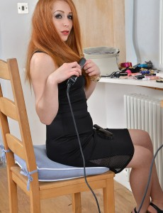 Spectacular Redhead Tia Jones  Opens to Show Her Furry Pussy As She Readies for Bed
