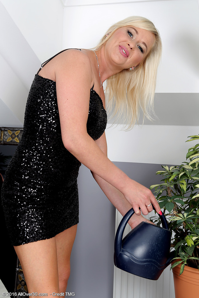Beatiful Golden-haired Evelina Jones Waters Her Plants and Taunts