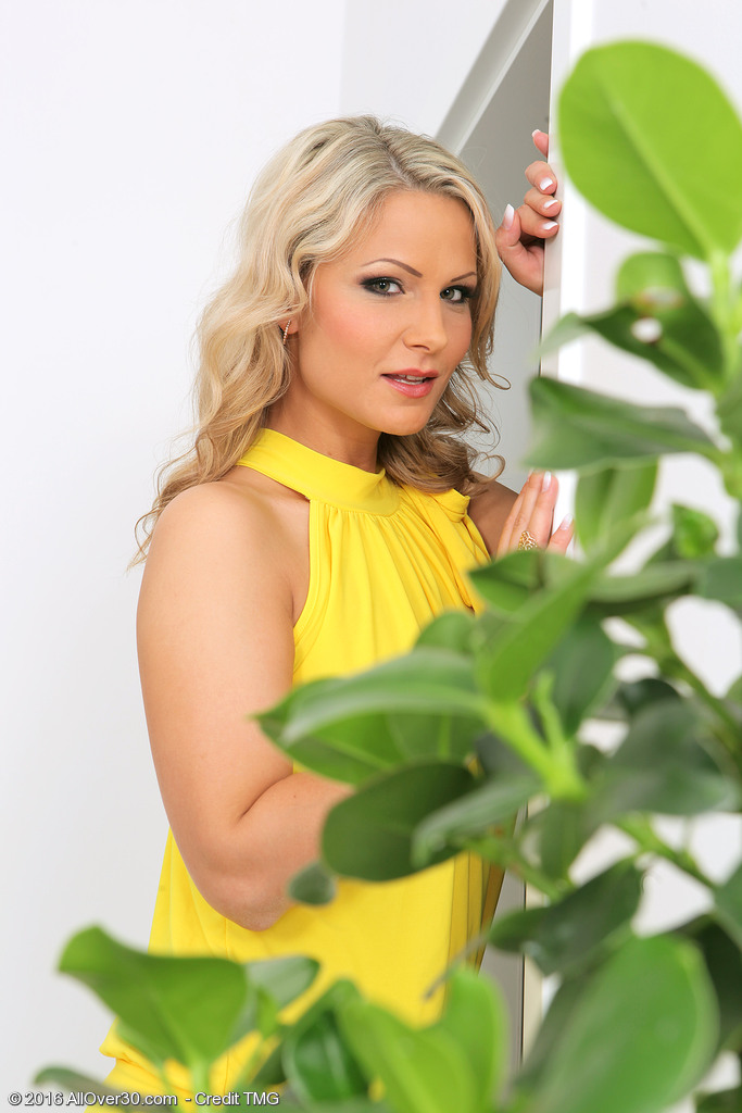 Beautiful  Blond Haired Holly B Waters Her Plants
